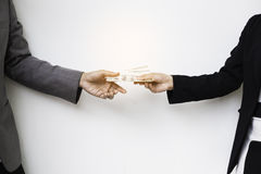 Close-up Of Person Hand Giving Money To Other Hand Stock Photo
