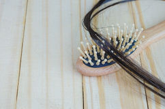 Close-up of person hand holding comb with loss hair Royalty Free Stock Photography