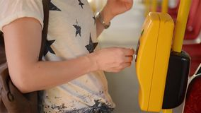 Close-up Of Person Hands Inserting Ticket in The Bus, young woman Inserting Ticket in the public transport. HD stock video footage