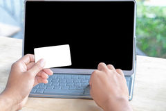 Close-up of person holding empty credit card or business card an Stock Image