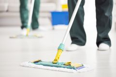 Person holding floor mop stock image