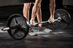 Person Lifting Barbell. Close-up Of A Person Lifting Barbell In The Gym Stock Image