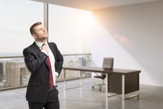 A close up of the person in the office. CEO at the working place in modern panoramic New York office. Stock Photos