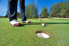 Close up of person putting golf ball on golf course Stock Photography