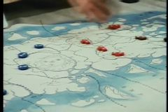 Close-up of person rearranging map indicators stock footage