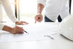 Close-up Of Person's engineer Hand Drawing Plan On Blue Print with architect equipment, Architects discussing at the table, team. Work and work flow stock photo