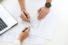 Close-up Of Person's engineer Hand Drawing Plan On Blue Print with architect equipment, Architects discussing at the table, team. Work and work flow stock images