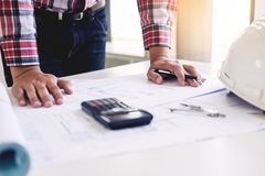 Close-up Of Person's engineer Hand Drawing Plan On Blue Print with architect equipment, Architects discussing at the table, team. Work and work flow stock photos