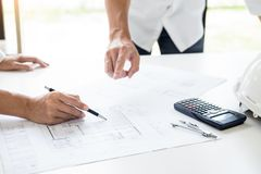 Close-up Of Person's engineer Hand Drawing Plan On Blue Print with architect equipment, Architects discussing at the table, team. Work and work flow royalty free stock image
