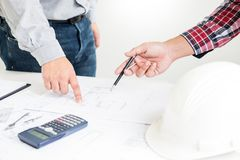 Close-up Of Person's engineer Hand Drawing Plan On Blue Print with architect equipment, Architects discussing at the table, team. Work and work flow royalty free stock photo