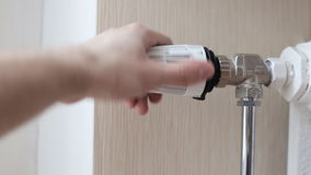 Close-up Of A Person`s Hand Adjusting Temperature Of Radiator Thermostat stock video