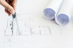 Close-up Of Person& x27;s Hand Drawing Plan On Blue Print with archit. Close-up Of Person& x27;s Hand Drawing Plan On Blue Print with architect equipment Stock Photos