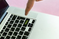 Close up person`s hand finger pushing the `diet` text on a button of laptop keyboard isolated concept v royalty free stock photography