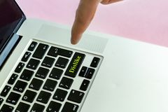 Close up person`s hand finger pushing the `dislike` text on a button of laptop keyboard isolated concept f royalty free stock photo