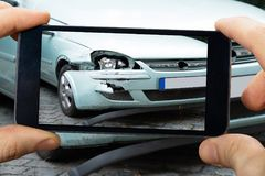 Person Capturing The Picture Of Broken Car Stock Photos