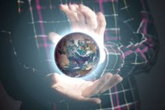 Close up person`s hands holding lighten planet earth, space concept. Elements of this image furnished by NASA stock photos