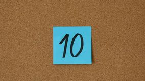 Close-up of the person sticking the numbers 0 to 10 on the board. Top 10 counter. Countdown - Awards stock video footage