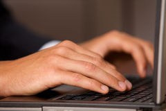 Close-up of person using laptop Stock Image