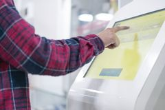 Close up person using touch screen panel in post office to recieve a package f royalty free stock image