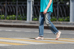 Close up of person walking on street Royalty Free Stock Photo