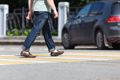 Close up of person walking on street Stock Image