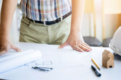 Close-up Of Person& x27;s Hand Drawing Plan On Blue Print with archit Stock Photos