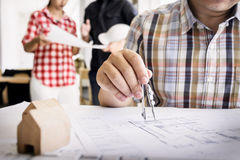 Close-up Of Person& x27;s Hand Drawing Plan On Blue Print with archit Royalty Free Stock Image