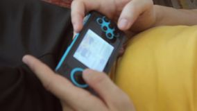 Close up of persons hands playing a game. stock footage