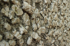 Close up perspective of Igneous Rock Surface Texture (wider). Close up perspective of igneous boulder surface texture, with camera at surface level looking Royalty Free Stock Images