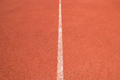 Close up perspective white line of Athletics track in sport stadium Royalty Free Stock Images