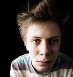 Close-up of perspiring tense teen stock image