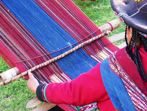 Close up of Peruvian lady in authentic dress spinning yarn by ha Royalty Free Stock Image