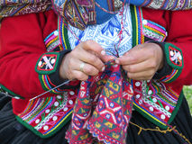 Close up of Peruvian lady in authentic dress spinning yarn by ha Stock Image