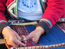 Close up of Peruvian lady in authentic dress spinning yarn by ha Royalty Free Stock Photos