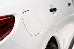A close up of a petrol cap cover. On a modern car stock image