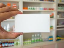 Close up pharmacist hand hold medicine box package Stock Photography