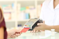 Pharmacist hands charging with credit card reader Stock Photo