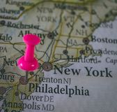 Close up of Philadelphia pin pointed on the world map with a pink pushpin royalty free stock photography