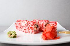 Close up philadelphia sushi roll with caviar stock images