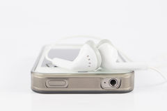 Close up phone headsets with mobile phone Stock Images