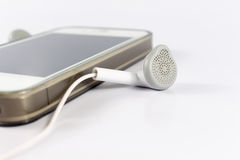 Close up phone headsets with mobile phone Stock Photos