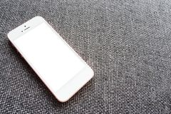 Close up phone mobile blank screen on sofa top view, mock-up royalty free stock photography