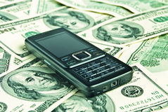 Close up phone on the money Royalty Free Stock Photo