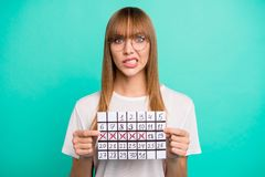 Close up photo amazing beautiful she her lady arms hands hold paper calendar not happy oh no expression miss few days. Vacation weekend wear specs casual white royalty free stock photography