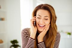 Close up photo amazing beautiful she her lady hands arms telephone speak tell talk say relatives friends sincere toothy. Beaming smile wear striped pullover royalty free stock photo