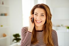 Close up photo amazing beautiful she her lady hands arms telephone speak tell talk say relatives friends sincere toothy. Beaming smile wear striped pullover stock photos