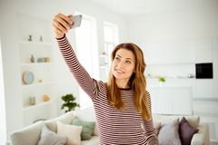 Close up photo amazing beautiful she her lady hands arms telephone speak tell talk say skype friends relatives make take. Selfies smile wear striped pullover stock photos