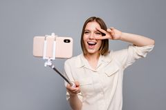 Close up photo amazing beautiful she her lady hold hands arms metal telephone stick make take selfies speak tell talk. Close up photo amazing beautiful she her stock photography