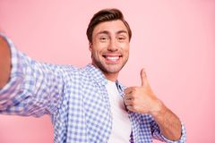 Close up photo of amazing brunet he him his handsome telephone make take selfie thumb up in air glad help girlfriend stock photography
