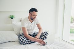 Close up photo amazing he him his guy good morning weekend workaholic notebook writing check currency white nightwear. Close up photo amazing he him his guy good royalty free stock image